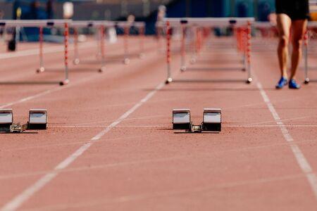 starting blocks in start running 100 meters hurdles on athletics