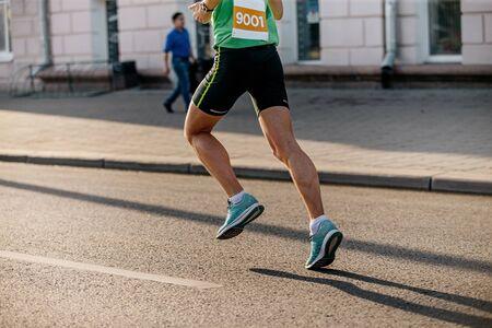 feet man athlete runner running on asphalt in city marathon