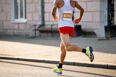 man athlete runner run marathon on city in soft sunlight Reklamní fotografie