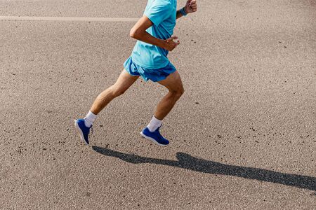 man runner to run along gray asphalt of top view