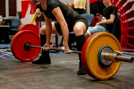 women powerlifter start attempt deadlift competition in powerlifting