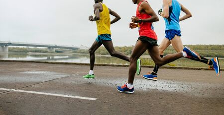 group runners running marathon race in river embankment