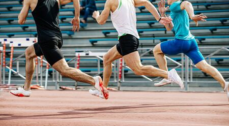 men 100 metres final running in athletics competition Stock Photo