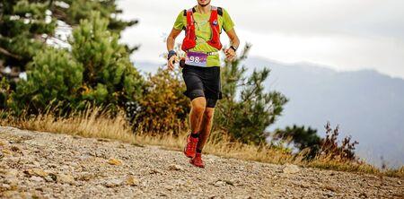 young male runner  run mountain ultra marathon