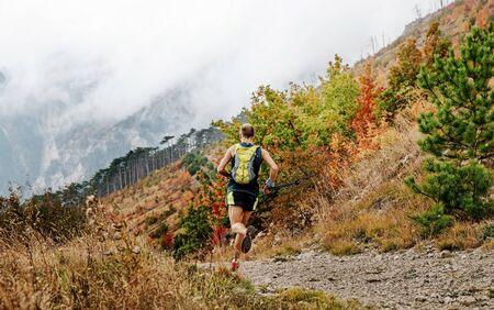 back trail running man run mountain marathon in autumn Reklamní fotografie