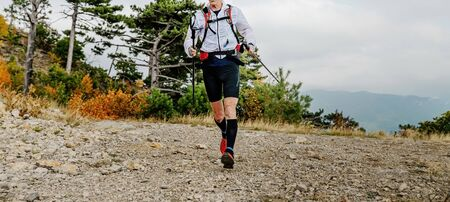 male runner with trekking poles run mountain trail marathon Reklamní fotografie