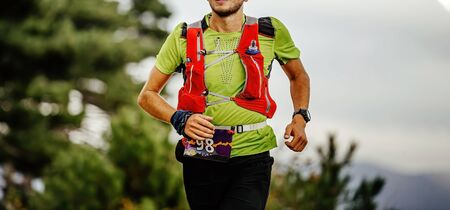 closeup runner athlete run ultra marathon