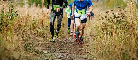 group of runners athletes run uphill trail vertical kilometer Reklamní fotografie