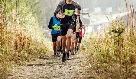 group runner athletes run mountain trail in rain Reklamní fotografie
