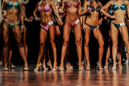 group young women in bright bikinis competitive fitness bikini