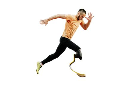 physically disabled athlete running with prosthetic legs on white background