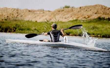 back athlete kayaker rowing kayaking competition race 写真素材