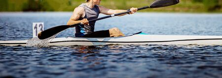 close up athlete kayaker rowing kayaking competition race 写真素材