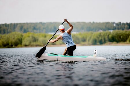 athlete canoeist rowing in lake. canoeing competition race 写真素材