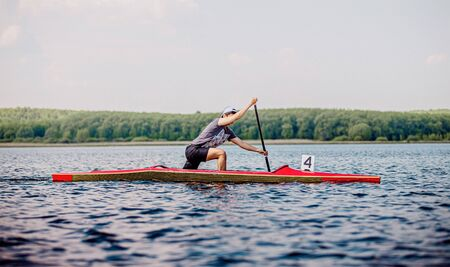 young athlete canoeist rowing canoeing competition race