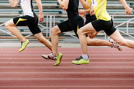 legs men athletes runners running race sprint in athletics Standard-Bild