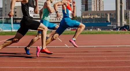 men sprinters run on track stadium in athletics competition Archivio Fotografico