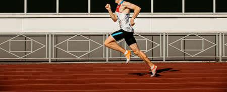 male runner sprinter run on track stadium in athletics