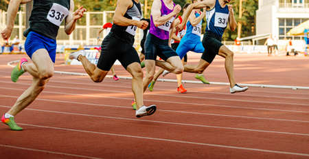 race group man runners sprinters run on track in athletics