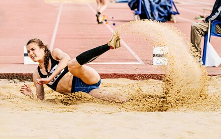 long jump in track and field event woman athlete Banque d'images