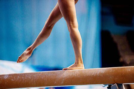 balance beam exercise legs young woman gymnast athlete Standard-Bild