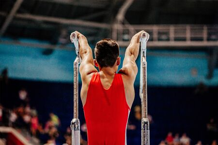 athlete gymnast exercise on parallel bars gymnastics