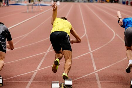 start runners sprinters 100 meters race track and field competition Foto de archivo