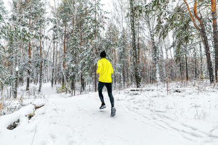 back male runner run winter forest trail race
