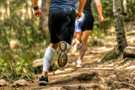 back man runner in compression socks running stones trail