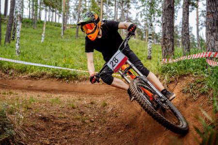downhill mountain biker riding turn of earth trail
