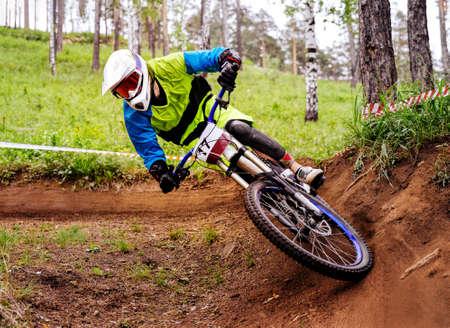 downhill athlete biker ride turn of earth trail