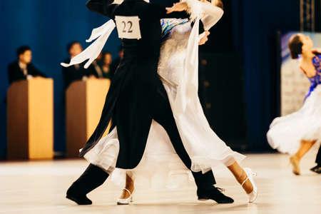 сouple of dancers man and woman dance waltz