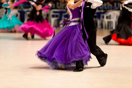 young couple dancers dancing waltz in competition Standard-Bild