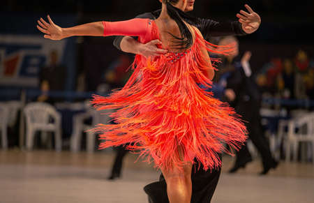female dancer latin dancing in red dress