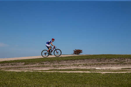 Yalta, Russia - April 30, 2021: man athlete mountain biker riding trail during MTB race