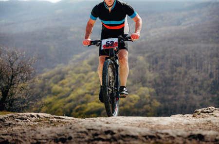 male athlete on mountainbike riding mountain trail on race Zdjęcie Seryjne