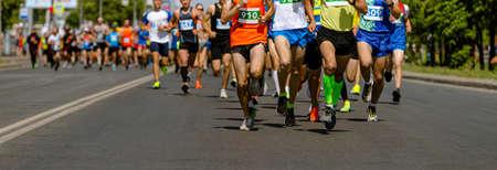 large group male runners athletes run marathon race