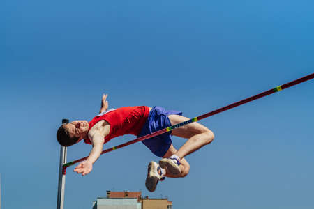 Chelyabinsk, Russia - June 6, 2021: male athlete attempt in high jump at Championships track and field