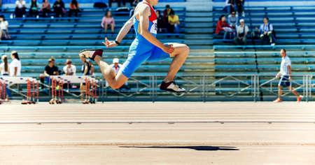 male athlete triple jump track and field competition Zdjęcie Seryjne