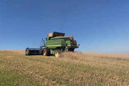 grain harvester harvesting wheat in fields of France