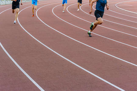 male runner leader sprint race at track and field competition