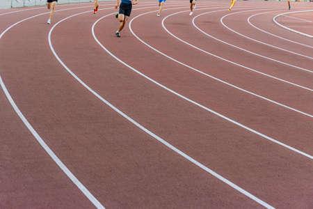 legs male runners athletes run on track race Zdjęcie Seryjne