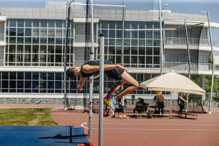 high jump male athlete successful attempt at competition
