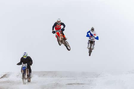 group of motorcycle racers winter race enudro