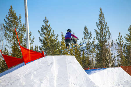 athlete snowboarder jump in snowboard competition