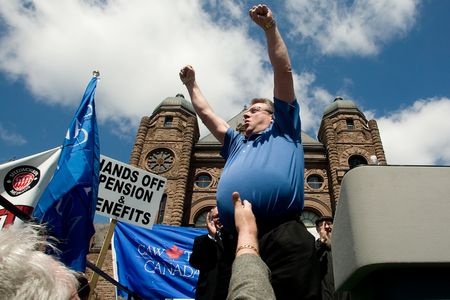 Toronto, Ontario, Canada:  April 23, 2009.  Canadian Auto Workers Union President Ken Lewenza raises his arms in defiance against the Provincial governments plan to not make pensions protected.