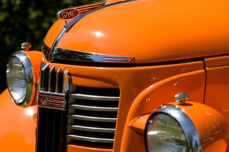 The front grill and headlights of a vintage General Motors Truck.