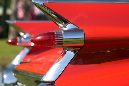 The tailfins and lights on a vintage Cadillac Fleetwood.