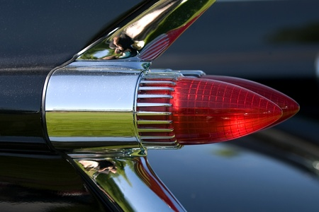 The tail lights on a vintage Cadillac Fleetwood.