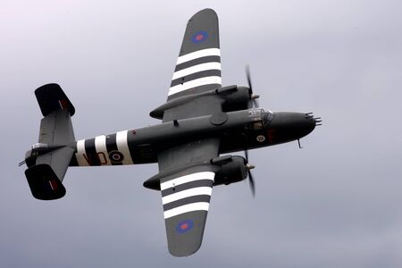 St Thomas, Canada. June 25, 2011. A World War II B-25 Mitchell bomber does a flypast at the Great Lakes International Air Show.